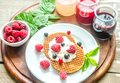 Belgian Waffles With Whipped Cream And Fresh Berries Stock Images - 42245834