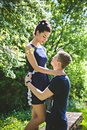 Man Holds Pretty Woman In Embrace Stock Photos - 42254153