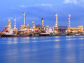 Beautiful Lighting Of Oil Refinery Industry Plant Beside Blue River Use For Energy Industrial Business Theme Royalty Free Stock Photo - 42263635