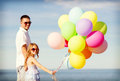 Happy Father And Daughter With Colorful Balloons Stock Image - 42265851