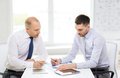 Two Serious Businessmen With Tablet Pc In Office Royalty Free Stock Photography - 42266507
