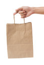 Hand Holding And Giving Paper Bag Isolated Over White Background Stock Photography - 42321202