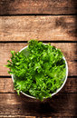 Fresh Green Salad In A Bowl On  Wooden Background - Lettuce Sala Stock Photo - 42337540