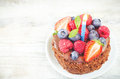 Chocolate Birthday Cake With Candle, Raspberries, Blueberries An Royalty Free Stock Images - 42341469