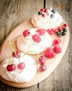 Meringue Cakes With Fresh Berries Stock Images - 42349724
