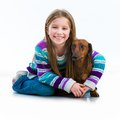 Happy Little Girl With Her ​​dachshund Stock Photos - 42363753