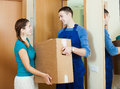 Courier In Uniform Brought Package To Girl Royalty Free Stock Photos - 42364588