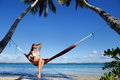 Young Woman In Bikini Sitting In A Hammock Between Palm Trees, O Royalty Free Stock Photos - 42372218