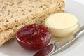 Two Slices Of Multigrain Bread With Jam And Butter Royalty Free Stock Photos - 42380758
