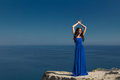 Summer Portrait. Beautiful Woman Standing On A Cliff Over Blue S Royalty Free Stock Photos - 42396028