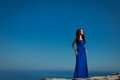 Beautiful Woman Standing On A Cliff Over Blue Sky. Brunette Girl Royalty Free Stock Images - 42396039