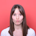 Portrait Of Girl With Funny Face Against Red Background Stock Image - 42449921