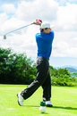 Golfer Swinging His Gear And Hit The Golf Ball Stock Photo - 42480910