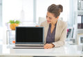 Happy Business Woman Showing Laptop Blank Screen Royalty Free Stock Image - 42509196