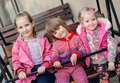 Small Children Ride On A Wooden Swing Stock Photo - 42510160