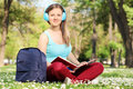 Female Student Reading A Book In Park Royalty Free Stock Image - 42516146