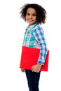 Smiling Little Girl Holding A Notebook Royalty Free Stock Photography - 42530397