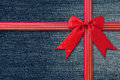 Blue Jeans Background With Red Bow. Stock Images - 42541814