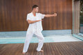 Handsome Man In White Doing Tai Chi Stock Image - 42544331