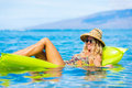 Young Woman Floating On Raft Royalty Free Stock Photo - 42549105