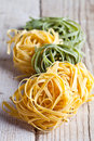 Yellow And Green Uncooked Pasta Tagliatelle Stock Photography - 42600352