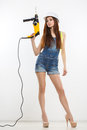 Sexy Builder Woman With A Drill In Her Hands Royalty Free Stock Photo - 42603125