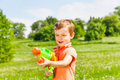 Little Boy Plays With A Water Gun Royalty Free Stock Photo - 42628235