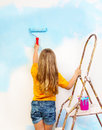 Little Girl Paints The Wall Standing On A Ladder Royalty Free Stock Photos - 42628578