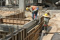 Two Construction Workers Installing Ground Beam Formwork Royalty Free Stock Image - 42631726