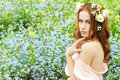 Beautiful Sexy Young Girl With Long Red Hair With Flowers In Her Hair, Sitting In A Field In Blue Flowers Stock Image - 42644281
