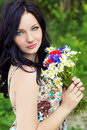 Young Beautiful Elegant Girl, Blue Eyes With Long Black Hair Standing In The Garden A Bouquet Of Daisies Poppies Royalty Free Stock Image - 42645956