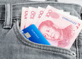 Chinese Yuan Banknote And Credit Card In The Grey Jean Pocket Stock Photos - 42653093