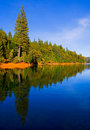 Reflection In Clear Blue Lake Royalty Free Stock Photos - 4272668