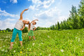 Boy And Girl Doing Gymnastics On A Meadow Stock Photography - 42701412