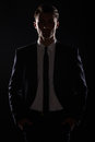 Handsome Business Man In Black Suite, Backlight Royalty Free Stock Photography - 42706247