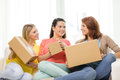 Smiling Teenage Girls With Cardboard Boxes At Home Stock Photo - 42706660