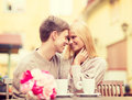Romantic Happy Couple Kissing In The Cafe Stock Images - 42710154