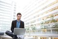 Young Business Man Using Laptop Royalty Free Stock Photography - 42738147