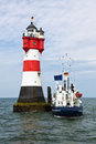 Supply Ship At Roter Sand Lighthouse Royalty Free Stock Image - 42738526