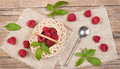 Top View Of Small Basket With Fresh Raspberries With Leaves Royalty Free Stock Images - 42744219