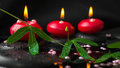 Spa Concept Of Passiflora Branch, Pearl Beads And Red Candles Stock Photos - 42751473