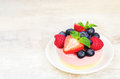 Souffle Cake With Fresh Raspberries, Blueberries And Strawberrie Royalty Free Stock Images - 42752099