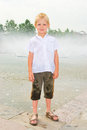 Boy Playing In The Fountain Stock Image - 42756831