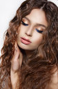 Daydreaming Brunette With Curly Hair And Blue Eyeshadows Royalty Free Stock Photo - 42772695