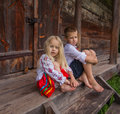 Ukrainian Children Near Old Wooden House Stock Photography - 42781662