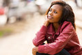 African Woman Daydreaming Stock Image - 42803081