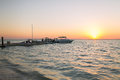 Boats Moored To Pier At Sundown Stock Image - 42829951