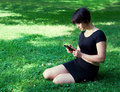 Girl Outdoor With Phone Stock Image - 42912301