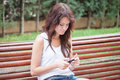 Annoyed Girl Typing Message On Cell Phone Royalty Free Stock Photos - 42920048