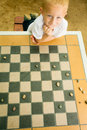 Child Playing Draughts Or Checkers Board Game Outdoor Stock Image - 42926591
